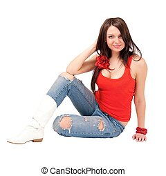 young woman sitting on a white background