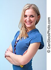 young woman standing against blue background