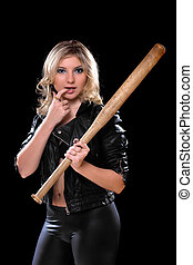 Sexy young woman with a bat