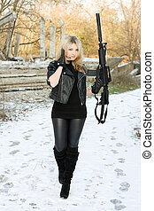 Sexy young woman with a gun