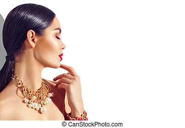 Sexy young woman with perfect makeup and trendy golden accessories