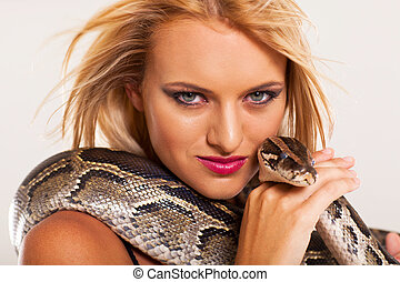 sexy young woman with python