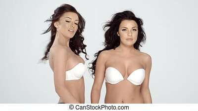 Sexy young women modelling bras - Sexy young women modelling...