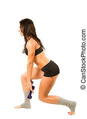 Sexy young yoga woman doing yogic exercise on isolated white background