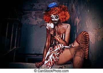 sexy zombie clown - Bloody scary clown. Halloween. Horror.