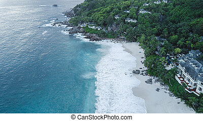 Seychelles beach Indian ocean from drone, shore and mountains.