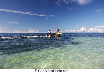 Seychelles Fisherman - Two fishermen on a boat in Seychelles...