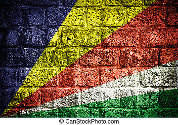 Seychelles flag painted on old brick wall