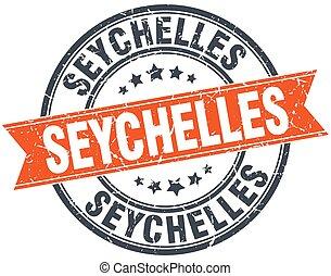 Seychelles red round grunge vintage ribbon stamp