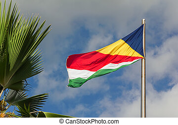 Seychelles waving flag on blue sky background