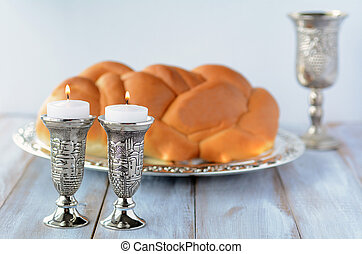 Shabbat candles with Challah and wine - Shabbat candles with...