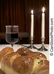 Challah, two candles, glass of wine, and all that is needed for Shabbat,