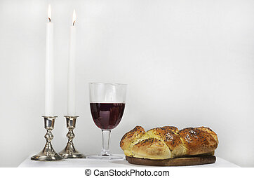 Shabbat observance includes Challah, candles lit, glass of wine.