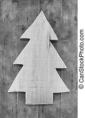 Shabby chic christmas decoration. Handmade carved tree on wooden