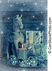 Shabby chic christmas decoration in silver with wooden horse, ca
