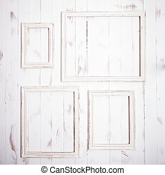 Shabby chic frames - Shabby chic white frames on wooden wall