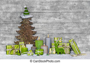 Shabby chic green and white christmas decoration on grey ...