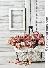 Shabby chic still life: bunch of vintage pink dry roses in...