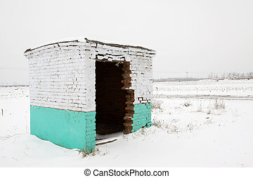 shabby houses in snow in winter