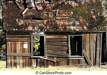 Shabby Shack - Shabby shack on side of road in the far...
