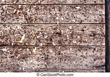 Shabby wooden wall with pins