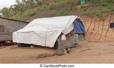 Shack Built of Tarps and Aluminum Siding - Handheld, medium...