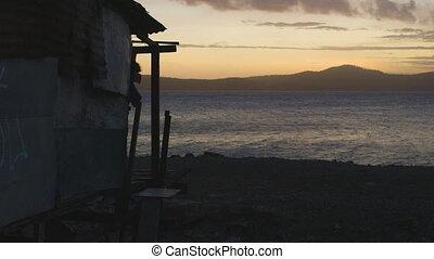 Shack House on Shore of Ocean