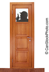 shade of stranger on the window of door from a dark tree