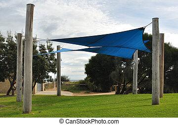 Shade sails on playground - Blue shade sails on kids...
