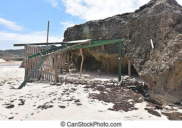 Dilapidated shade structure on Andicuri beach in Aruba.