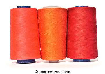 Shades of red thread - Reels of red and orange thread on...