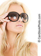 shades - picture of blonde in big shades over white