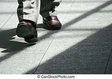 shadow - dress shoes on marble floor