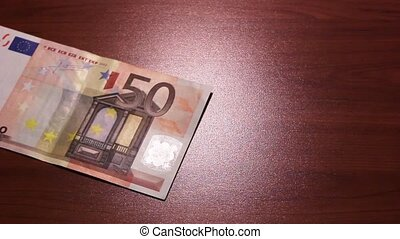 Shadow economy. 50 Euro. Money falls in the ancient chest....
