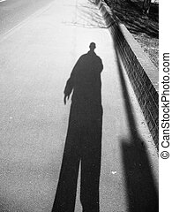 A black and white shadowy image of a man.