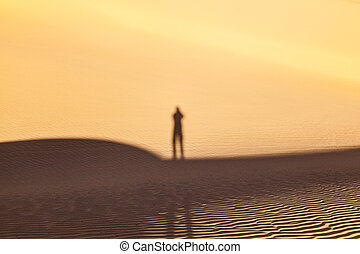 shadow of a man in the desert