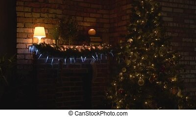 Shadow of a man walking with a flashlight around a Christmas tree