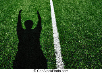 Shadow of American Football Referee Signaling Touchdown -...