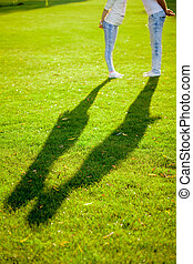 Shadow of Couple Kissing on Grass