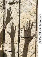 Shadow of hand  - Shadow of humans hand on the stone wall