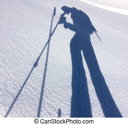 shadow of hiker on the snow