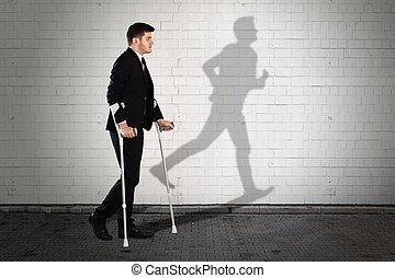 Shadow Of Man On Wall With Businessman Walking On Sidewalk