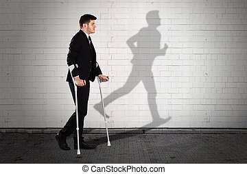 Shadow Of Man On Wall With Businessman Walking On Sidewalk
