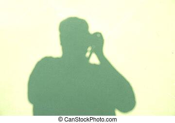 shadow of man take photo