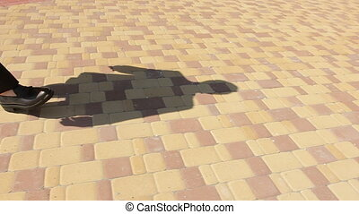 Shadow of Man Walking on Pavement