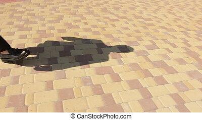 Shadow of Man Walking on Pavement
