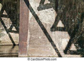 shadow of the bridge on wall