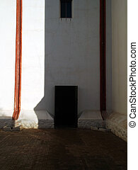 Shadow on Door at Church Courtyard