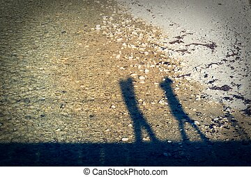 Shadow silhouette of a couple walking.