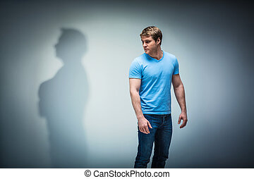 Shadow - Young man with shadow in studio